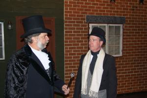 Ebeneezer Scrooge and Bob Cratchit