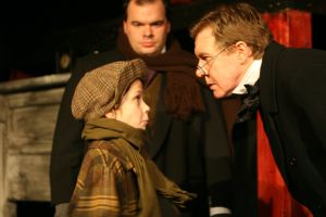 Caroler, Bob Cratchit and Scrooge