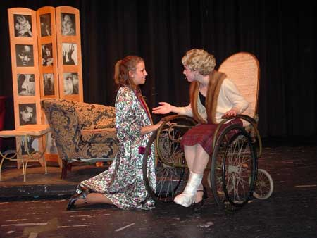 Dorothy Brock (Candace Scholz) giving Peggy Sawyer (Kathleen Wheeler) advice before the curtain goes up on 'Pretty Lady.'