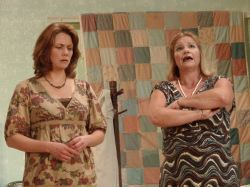 Lenny Magrath (Cynthia Huesman) and Cousin Chick (Mary Fettes) discuss family problems