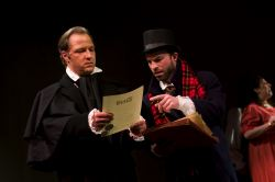 Scrooge (Brent Stone) and Crachit (Bill Walker)