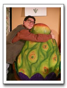 Ryan Schaffer as Seymour Krelborn and Audrey II, as voiced by Antonio Bullock and puppeteered by George Rouse