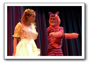 Cassie Youhouse as Alice and Callie Seaman as Cheshire Cat