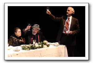 Mark O'Brien, right, and Jan Forbes toast the bride and groom at the wedding feast