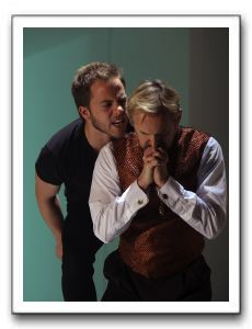 Hamlet (Graham Michael Hamilton) debates killing Claudius (David Whalen) while he prays.