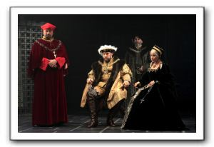 Anthony Cochrane (Cardinal Wolsey), Ian Merrill Peakes (King Henry VIII), Lawrence Redmond (Duke of Norfolk), and Naomi Jacobson (Queen Katherine)