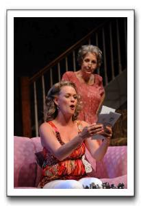 Melissa (Beth Hylton) offers some great reading material to Mary (Brigid Cleary)