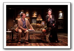 Florence Lacey (as Norma Desmond) discusses her opus screenplay of Salomé with D.B. Bonds (Joe Gillis)