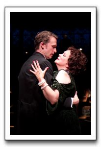 Florence Lacey (as Norma Desmond) gives a warm New Year's Eve embrace to D.B. Bonds (as Joe Gillis)