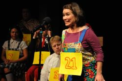Spelling Bee contestant Olive (played by Chrissy Barnett Miller) takes her turn. Also pictured, Kim Frias, Alden Michels, Katrina Janson,and Doe Kim.