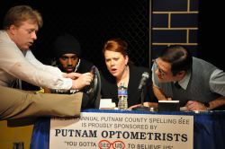 Spelling Bee contestant William Barfee (played by Alden Michels) shows school officials his 'magic foot.' Also pictured are Carl Williams, Kathleen Richards, and Jason Damaso.