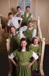 The Von Trapp Family children from front to back: Kimberly Geipel, Jamie Unrath, Brooke Miller, Rachel Rollins, Tommy Richman, Lexi Frilles, and David Capen