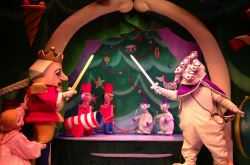 The Nutcracker and his toy soldiers battle the Mouse King and his minions
