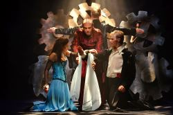 Natalie Berk as Juliet, Irakli Kavsadze as the Friar, and Alex Mills as Romeo