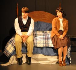 Benjamin Braddock (Zachary Hamilton) and Elaine Robinson (Heather Martin) discuss their futures.