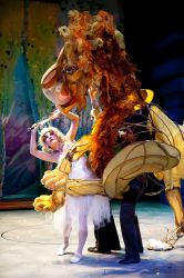 Aslan (puppeteers Michael John Casey, Betsy Rosen, Tracy Ramsay) fights the White Witch (Morgann Rose)