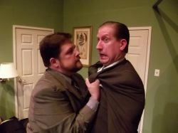 Mob hit man Todd (Jim Adams) and Agent Frank (Eric Small) security guard for the Mayor have a tense moment.