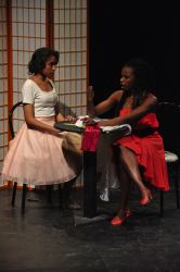 Maria (Kiah Simms)  and Anita Abby Stephenson in the bridal shop