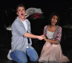 Tony (Ben Coleman) and Maria (Kiah Simms) singing 'One Hand/One Heart'