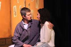 Otto Frank (Drew Holcombe) comforts his daughter Anne (Catherine Ariale) after a nightmare