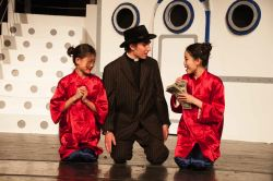 Ryan Savage (as Moonface Martin) 'reforms' Lauren Eng (left, as Ching) and Makiko Miyazaki (as Ling)