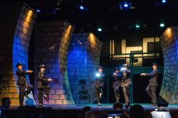 Officer Lockstock (Jackson Lessler) and Officer Barrel (Ashlyn Custer) lead the Urinetown police in 'Cop Song'