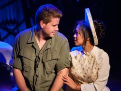 American GI Chris (Gannon O'Brien, left) and Vietnamese bargirl Kim (Diana Huey) find love during wartime