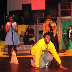 Adhana Reid (Dorothy), TreVaughn Allison (Lion), and LeAnn Dunn (Wicked Witch of the West Evillene)