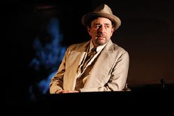 Richard Schiff as Erie Smith