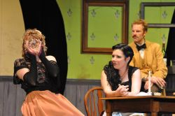 Melissa Dunlap as Suzanne, Annie Ermlick as Germaine, David Carter as Einstein. Suzanne demonstrates how Picasso looks at refraction to Germaine, the barmaid, and Gaston, a patron of the bar