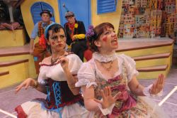 Foreground: Nora Achrati as Zerbinette and Megan Dominy as Hyacinth. 	Background: Michael Glenn as Scapin with Bradley Foster Smith as Sylvestre