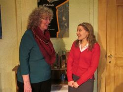 New theater intern Heidi Bishop (Emily Sucher) tells author Tina Fike (Linda Hirsch) how much she admires her work