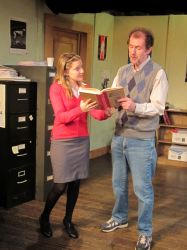 New theater intern Heidi Bishop (Emily Sucher) shows theater dramaturge Jim Foley (Nick Sampson) the text of a book that made her decide to go into theater