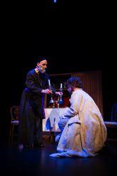 The bishop (Rick Kenney) and Jean Valjean (Michael Reid)