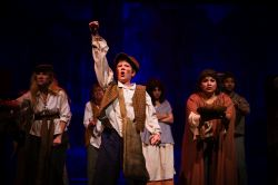 Gavroche (Ethan Van Slyke) and the beggars of Paris