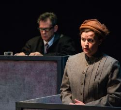 Mary Beth Luckenbaugh as Maria Wallner. Background: Tel Monks as Judge Ives.