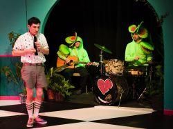Tony Strowd as Jonathan. In back Steve Przbylski (guitar) and Vaughn Irving (drums) as Musical Venus Flytraps