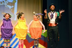 Melissa Handel, Faith Skeen and Mia Parnaby as Oompa-Loompas and Sedrick Moody as Willy Wonka